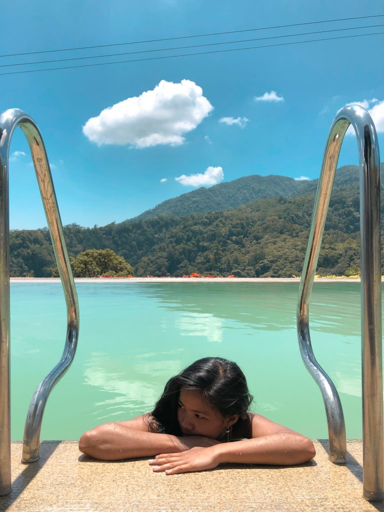 """ALT=""""lounging at infinity pool in bataan resort"""""""
