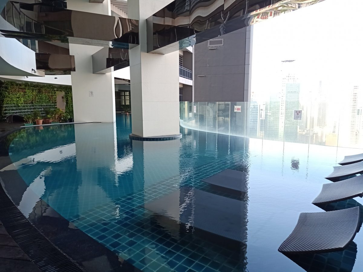 """ALT=""""gramercy residences zen rooms and the stunning view of the pool"""""""