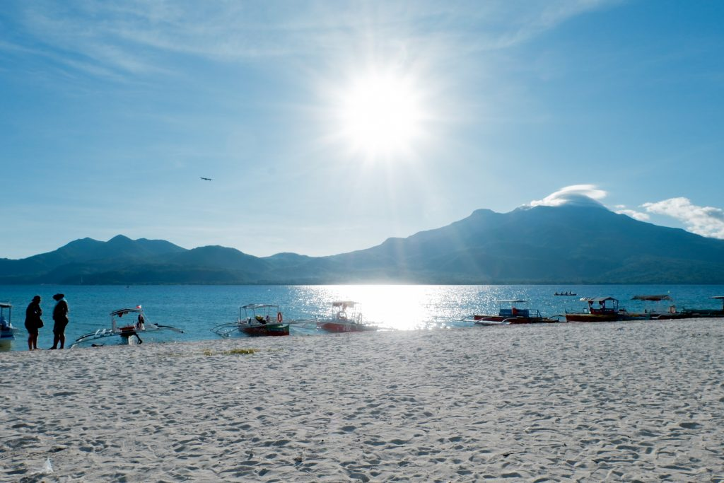 "ALT=""camiguin travel guide mantigue island sunset"""