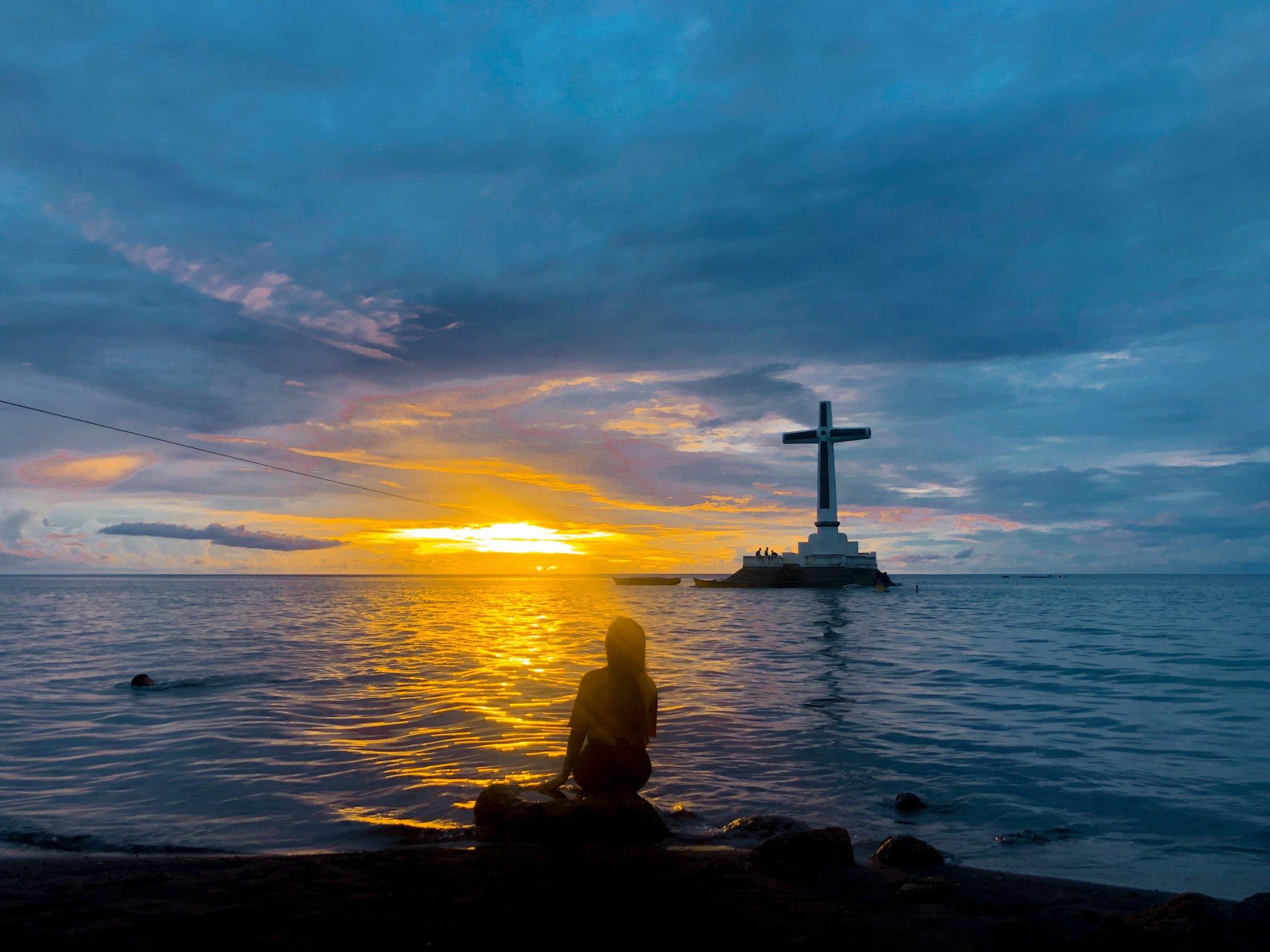 """ALT=""""sunken cemetery sunset view camiguin island"""""""