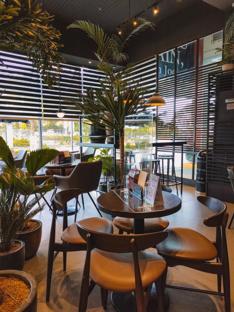 a cozy cafe with plants